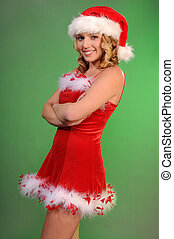Pretty blonde teenager in a Santa's helper outfit