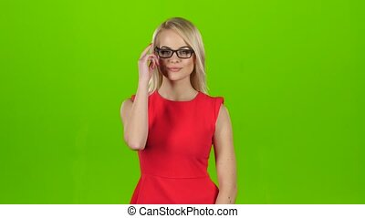 Pretty blonde winks her eyes off glasses, green screen...