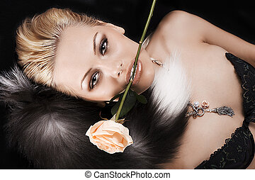 pretty blonde with a rose in her mouth