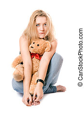 Pretty blonde with a teddy bear