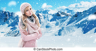 Pretty blonde with white mountains in the background