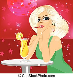 woman drinking orange juice with straw