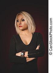 Pretty blonde woman in black dress