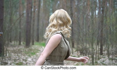 pretty blonde woman in the forest