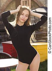 Pretty blonde woman in underwear at the street