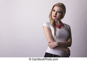 Pretty blonde woman over a grey background