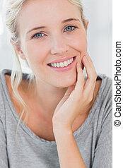 Pretty blonde woman smiling