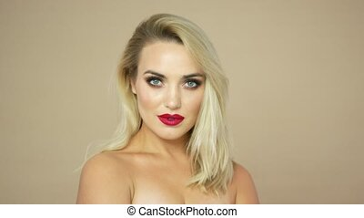 Pretty blonde woman with red lips - Portrait of pretty young...
