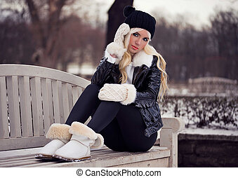 Pretty blonde young girl in posing outdoors