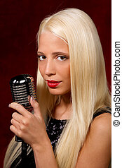 Pretty boy singer - Young blonde girl with the microphone in...