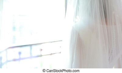 Pretty bride posing on a camera