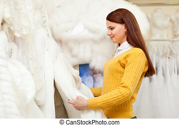 pretty bride shopping for wedding outfit in bridal boutique