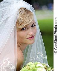 Pretty bride with bouquet