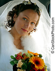 Pretty bride with bouquet