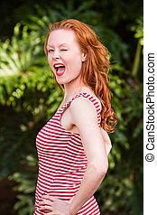 Pretty brunette caucasian danish woman winking