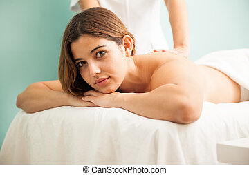 Pretty brunette getting a massage