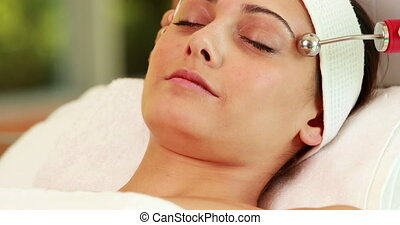 Pretty brunette getting micro dermabrasion treatment at the...