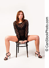 Pretty brunette girl on chair