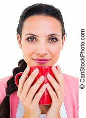 Pretty brunette holding a mug