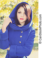 pretty Brunette in a blue coat, tinted