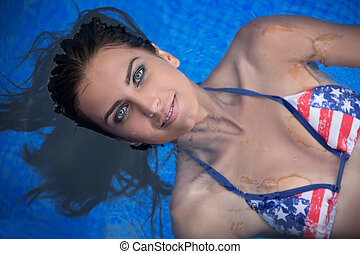 Pretty brunette in a bright swimsuit
