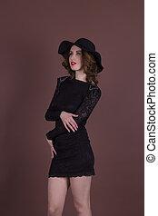 Pretty brunette in a fashionable dress