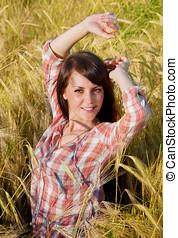 Pretty brunette in a field
