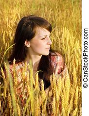 Pretty brunette in a wheat