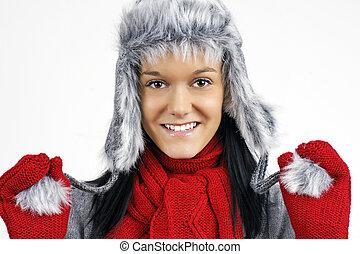 Pretty brunette in faux fur winter hat