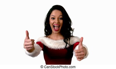 Pretty brunette in santa outfit showing thumbs up in slow...