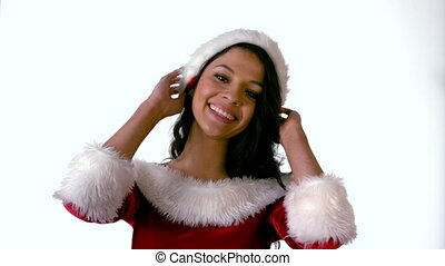 Pretty brunette in santa outfit smiling in slow motion