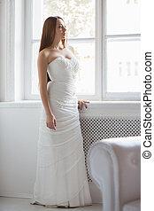 Pretty brunette in white wedding dress