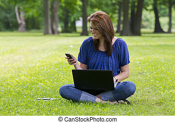 Pretty Brunette Model On Computer - A beautiful brunette ...