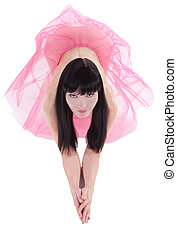 Pretty brunette naked woman in a pink skirt kneeling on the floor