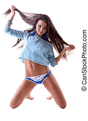 Pretty brunette playing with long hair in studio