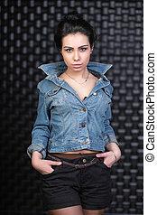 Pretty brunette posing in the studio.