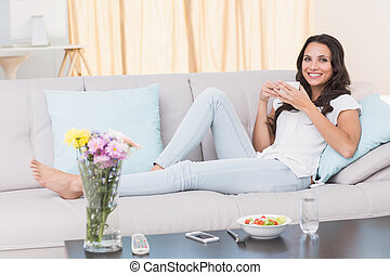 Pretty brunette relaxing on couch