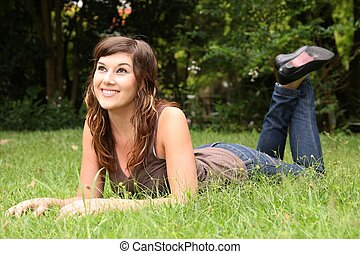 Pretty Brunette Resting on Green Grass
