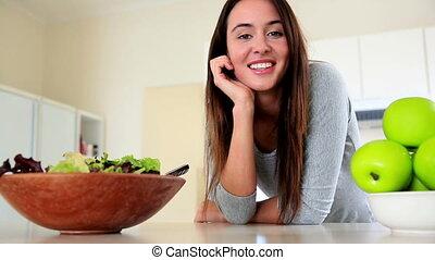 Pretty brunette smiling at camera