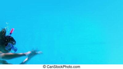 Pretty brunette swimming underwater