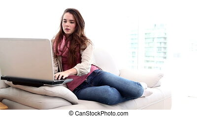 Pretty brunette using laptop