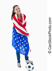 Pretty brunette wearing the american flag with football