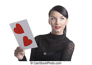 pretty brunette with valentine postcard looks up