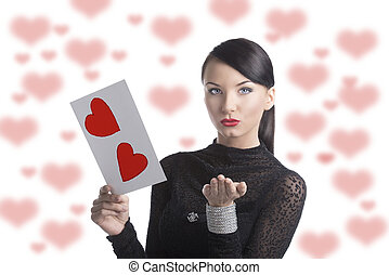 pretty brunette with valentine postcard send a kiss