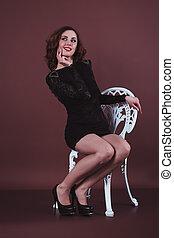 Pretty brunette woman in a black dress