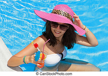 Pretty brunette woman in a swimming pool