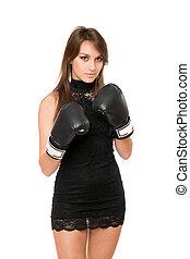 Pretty brunette woman in boxing gloves