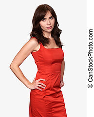 pretty brunette woman in red dress isolated