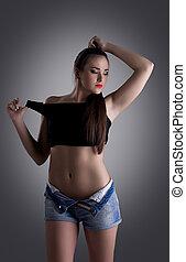 Pretty brunette woman in undress black top