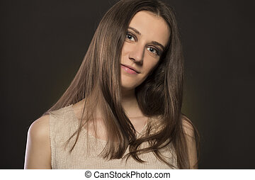 Pretty brunette woman on a black background